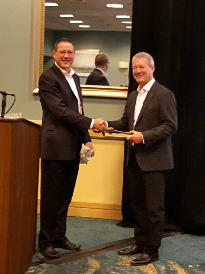 Eric Persson presents award to outgoing chair Ernie Parker